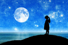 Silhouette, Little Girl Child Standing On A Hill By The Sea Looking At The Starry Sky.