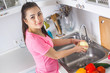Young housewife washing fresh vegetables