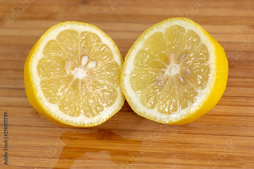 Close up of a lemon sliced in two.