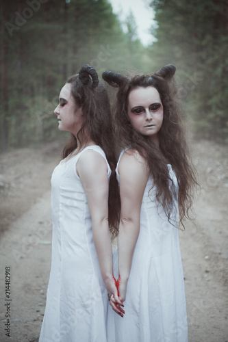 Cuadros en Lienzo Two twins demons with horns in forest
