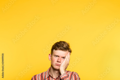 Fotografie, Obraz  bored disinterested weariful indifferent unenthusiastic man