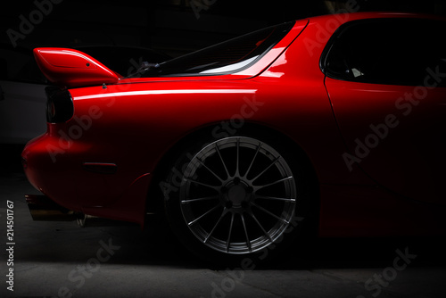 Fotografía  Car detailing series: Closeup of clean red sports car