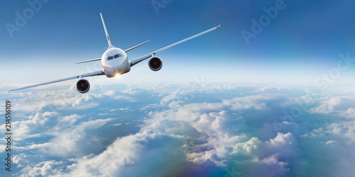 Ingelijste posters Vliegtuig Commercial airplane flying above dramatic clouds.