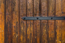 Weathered Plank Wood Gate Door With Wrought-Iron Hinge Latch. Dark Brown Earhy Color. Grungy Aged Texture Antique Look. Seamless Pattern. Backdrop Wallpaper Template With Copy Space
