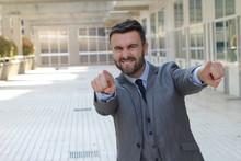 Confident Businessman Pointing...