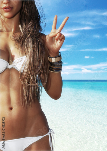 Fotografie, Obraz  A happy tan girl at the beach holding up a peace symbol with blue sky's and crystal clear surf in the background