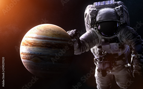 Garden Poster Brown Jupiter on a blurred background with a giant astronaut. Elements of the image are furnished by NASA