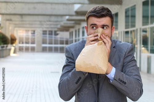 Fotografía  Businessman having a panic attack