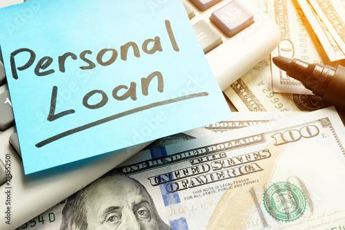 Fotografía  Personal loan. Calculator, dollar bills and pen.