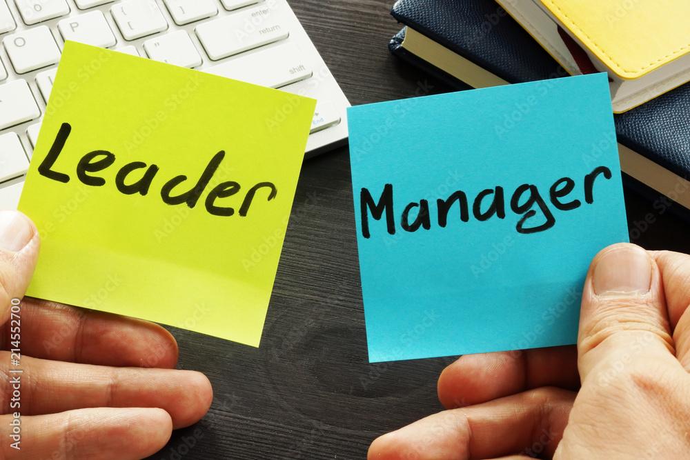 Fototapeta Leader vs manager. Man is holding memo sticks.