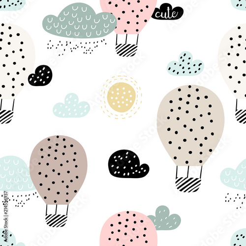 Baby seamless pattern with hot air ballon in the sky. Perfect for fabric, textile, wrapping. Cute cartoon background. Scandinavian style.