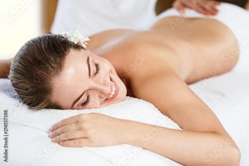 Fotografie, Obraz  Beautiful woman lying on massage table and enjoying massage.