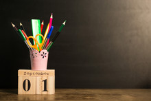 1st September Set On Calendar On Black Chalkboard Background With School Supplies. Back To School Concept. Student Workplace Background