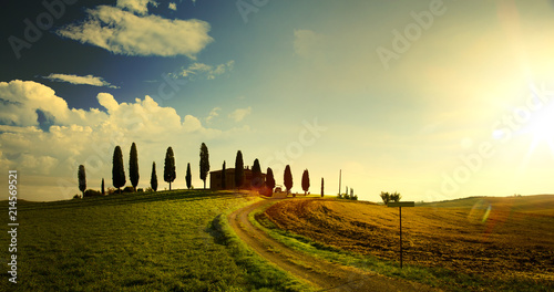 Spoed Foto op Canvas Beige typical Tuscany countryside landscape; sunset over rolling hills and Tuscany village
