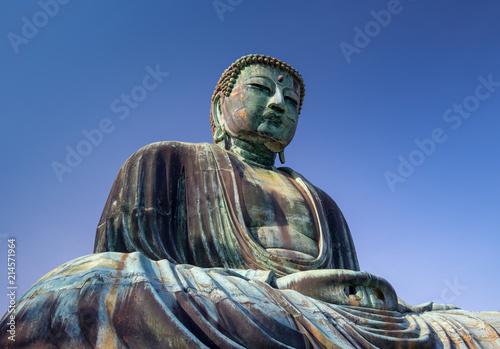 Tuinposter Boeddha Great Buddha bronze statue under a blue sky, Kamakura Japan
