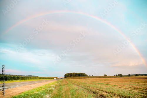 Foto op Canvas Lichtblauw Rainbow Rural landscape with wheat field on sunset