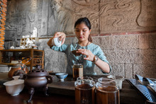 Woman Making Preparations For Tea