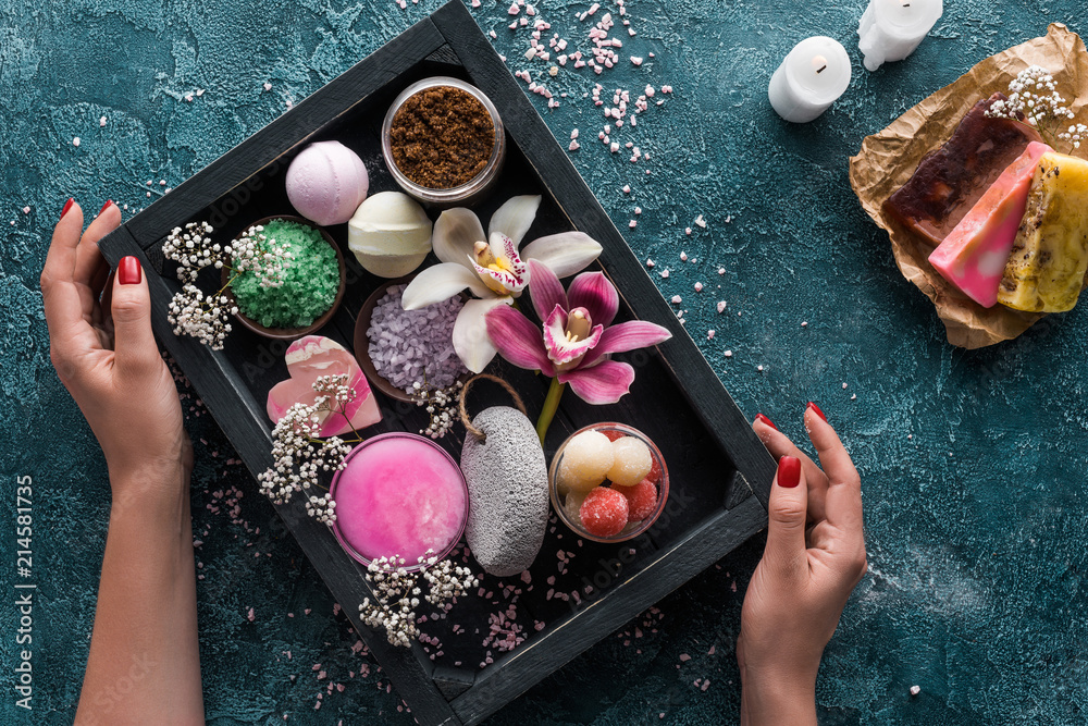 Fototapety, obrazy: cropped shot of human hands and box with organic spa accessories and flowers