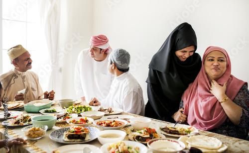 Stampa su Tela Muslim family having a Ramadan feast
