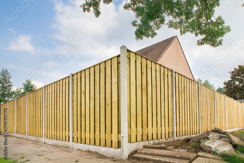 Tablou Canvas New wooden fence at garden of house