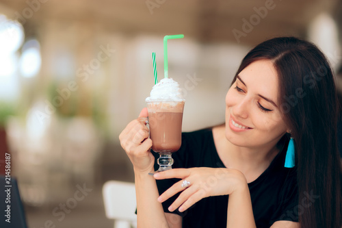 Girl Holding Coffee Drink with Whipped Cream on Top