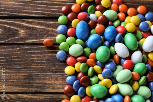 Garden Poster Candy Delicious colorful candies on wooden background