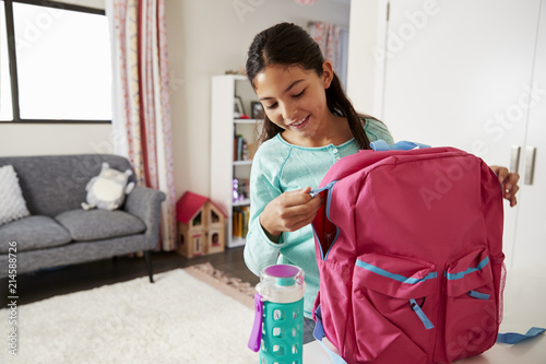 Obraz Young Girl In Bedroom Zipping Up Bag Ready For School - fototapety do salonu
