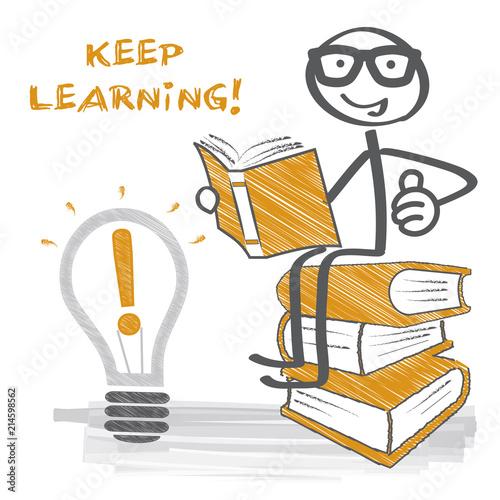 Fotografie, Obraz  Keep learning - Strichmännchen auf Bücherstapel liest ein Buch