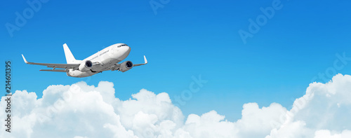 Poster Airplane Passenger aircraft cloudscape with white airplane is flying in the daytime sky cumulus clouds, panorama view.
