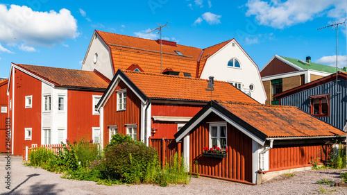 Historic alley with boatswain cabins and vintage houses in Vastervik, Sweden Canvas Print