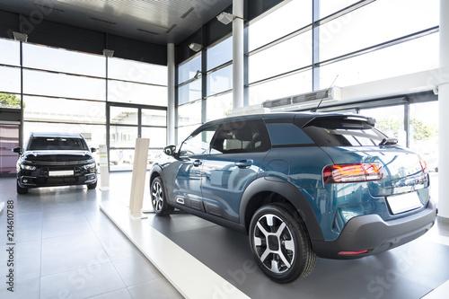 New Shiny Navy Blue Car Standing On Platform In Modern Car Showroom