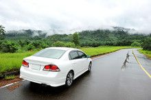 White Car On The Wet Road In Rainy Season
