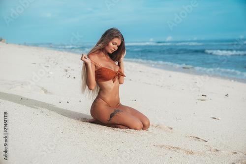 Sexy girl taking off her bra