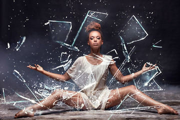 Young afro girl posing over water and glass.