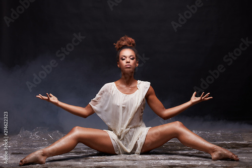 Young afro girl posing over water.