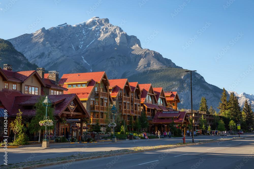 Fototapeta Banff, Alberta, Canada - June 17, 2018: Beautiful view of Banff City during a vibrant summer day.