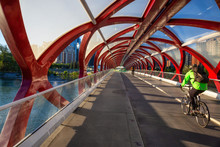 Peace Bridge Across Bow River During A Vibrant Summer Sunrise. Taken In Calgary, Alberta, Canada.