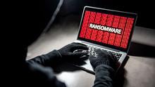 Male Hacker Hand On Laptop Com...