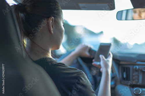Driving and texting in car with blue tone Tapéta, Fotótapéta