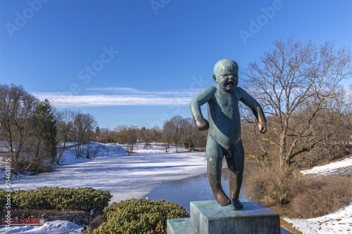 OSLO, NORWAY - APRIL 6, 2018: Oslo city skyline at famous Angry Boy Statue in Vigeland Sculpture Park, Oslo, Norway