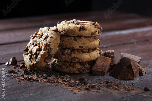 Chocolate cookies on table. Chocolate chip cookies shot with chocolate