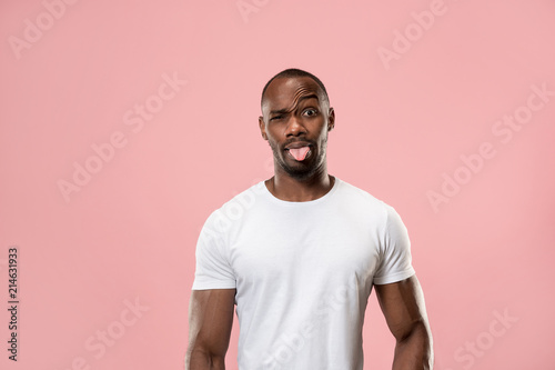 Fotografie, Obraz  The squint eyed man with weird expression isolated on pink