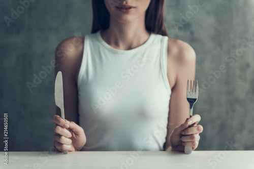 Close up. Young Woman Sitting with Knife and Fork. Canvas-taulu