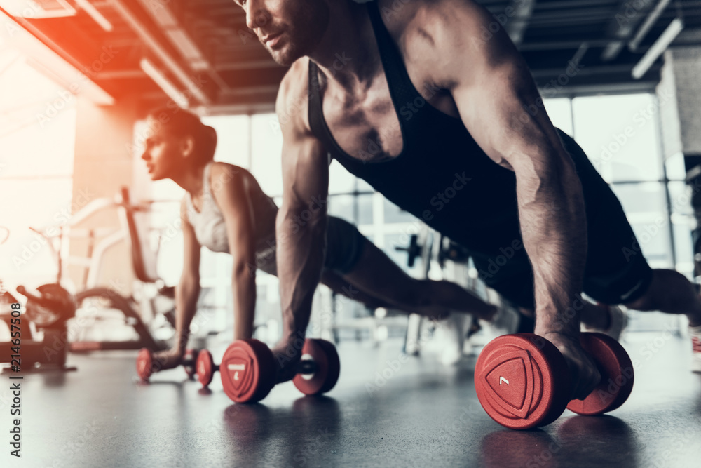 Fototapety, obrazy: Young Man and Woman Training in Fitness Club.