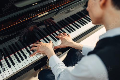 Obraz na plátně Pianist playing music on grand piano