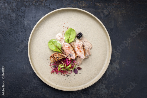 Valokuva  Fried pork fillet with salad and fruits as top view on a plate with copy space