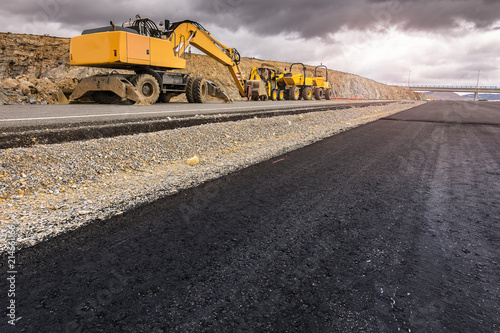 Fotografía  Repair of a road after a storm. By heavy machinery