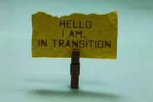 Text Sign Showing Hello I Am.. In Transition. Conceptual Photo Changing Process Progressing Planning New Things Paperclip Hold Torn Yellow Page Written Brown Words Sky Blue Background.