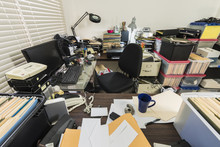 Messy Business Office With Pil...