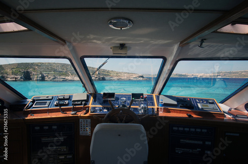 Inside view on the boat cockpit on the Blue Lagoon, Comino, Malta